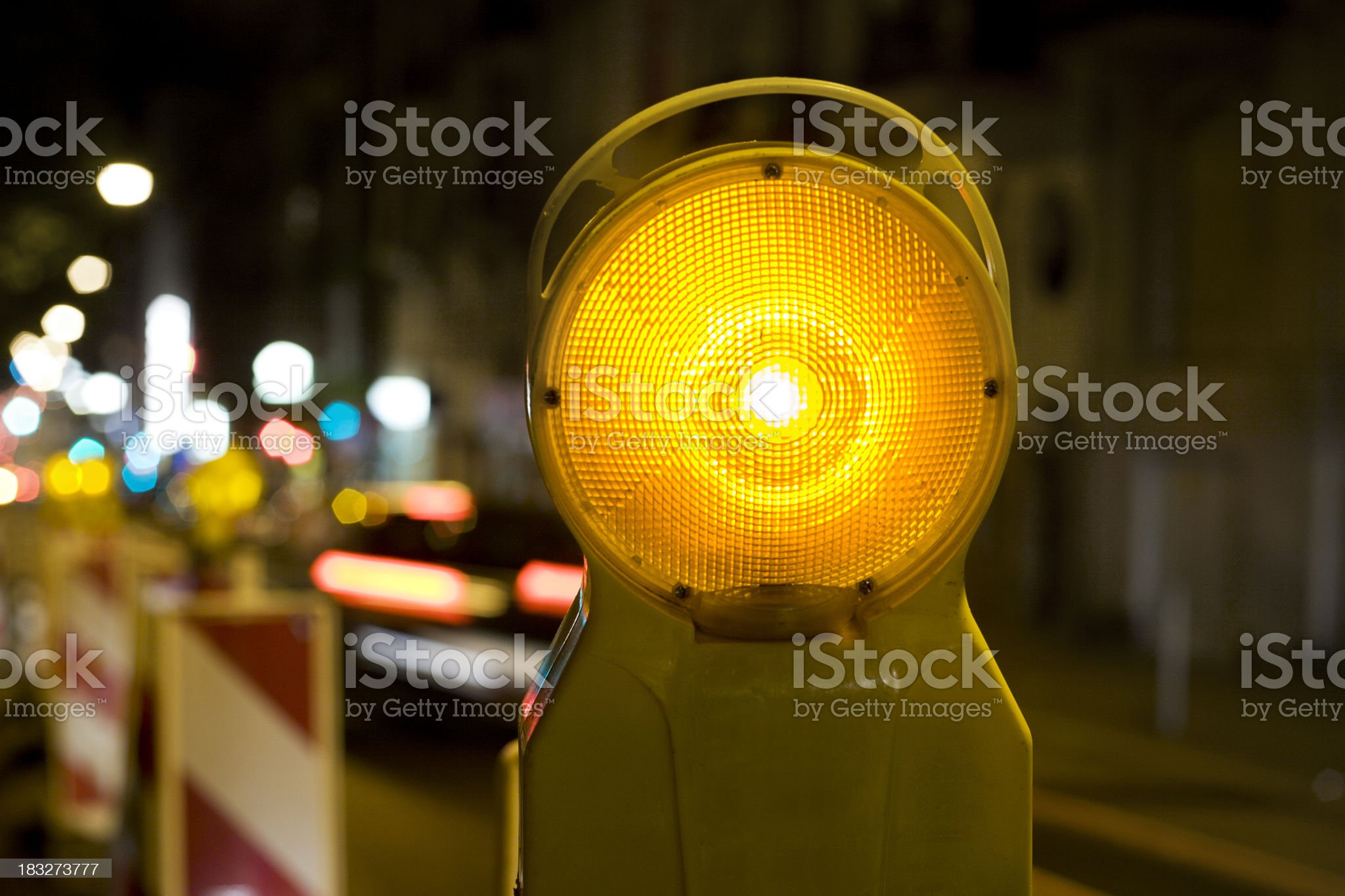 Street barricades light at night - traffic in the background royalty-free stock photo