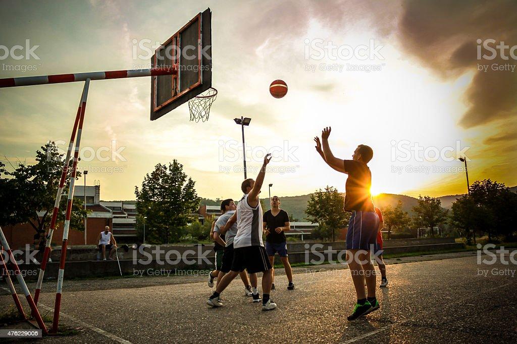Street basketball at sunset stock photo
