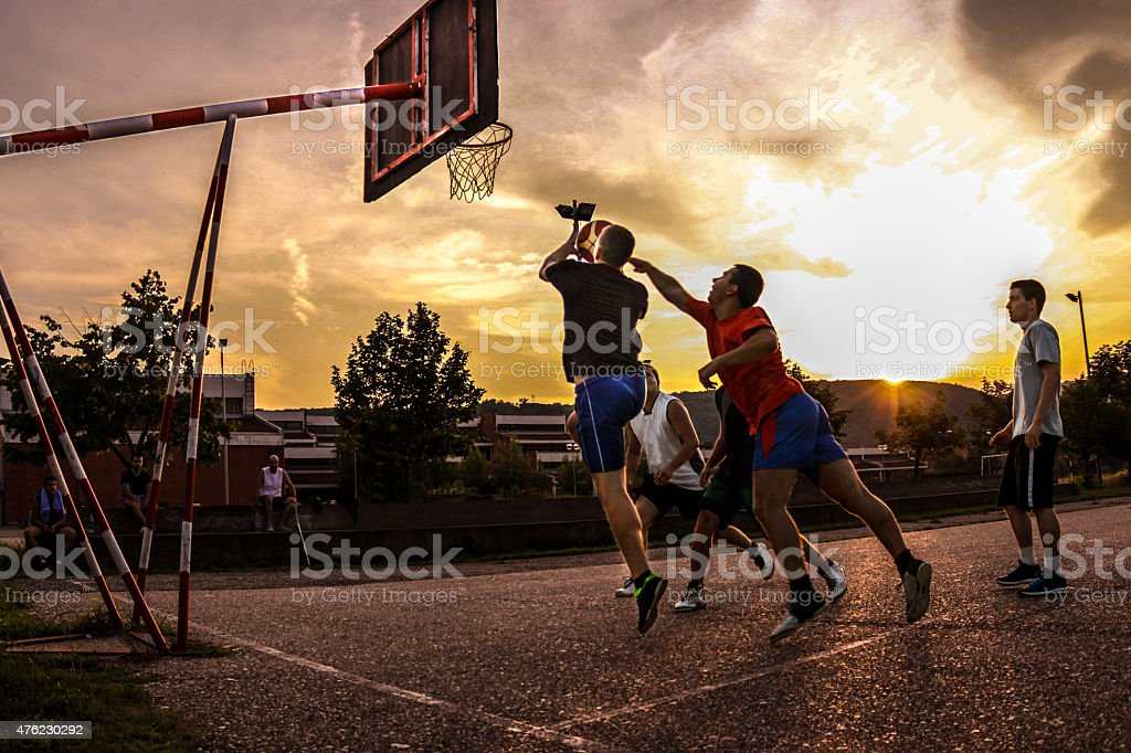 Street basketball at sunset stock photo