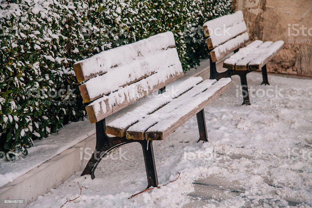 Street bench in snow stock photo