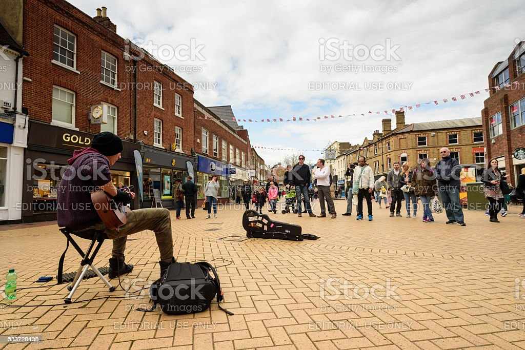 Street Busker Entertaining Crowds of Shoppers stock photo