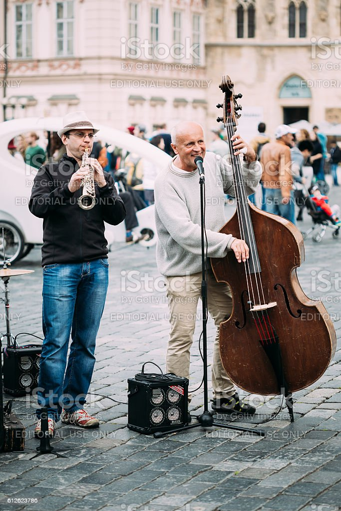 Street Busker performing jazz songs at Town Square in Prague stock photo
