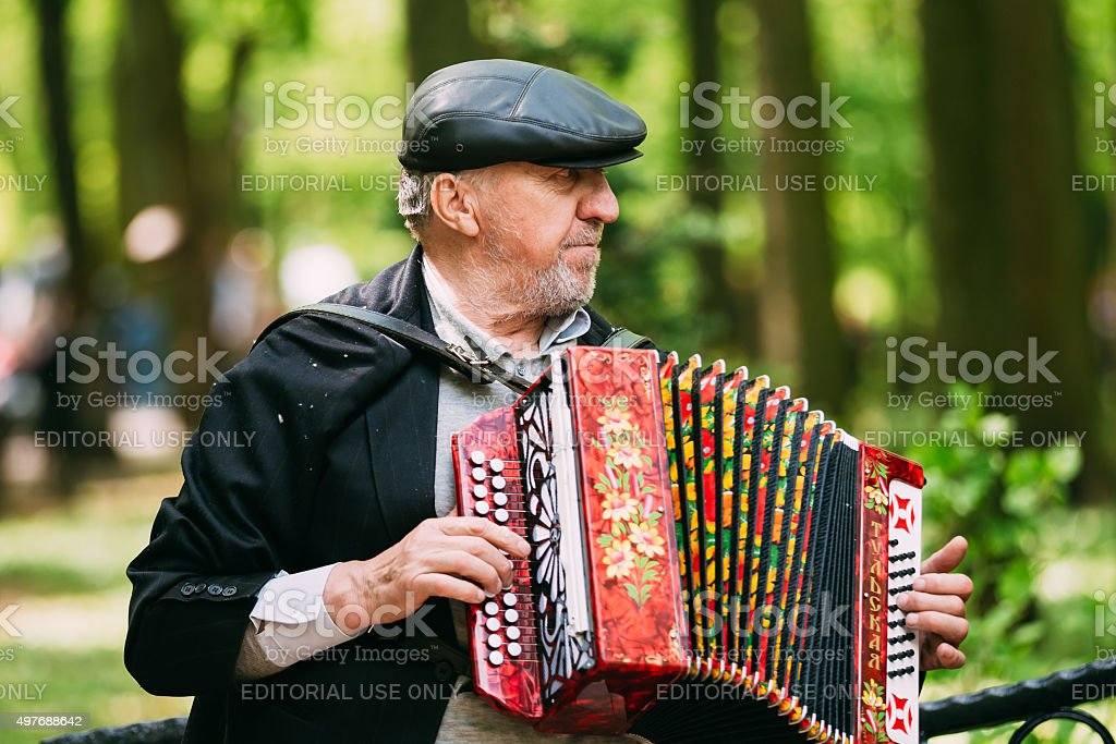 Street Busker performing songs in city park in Gomel, Belarus stock photo