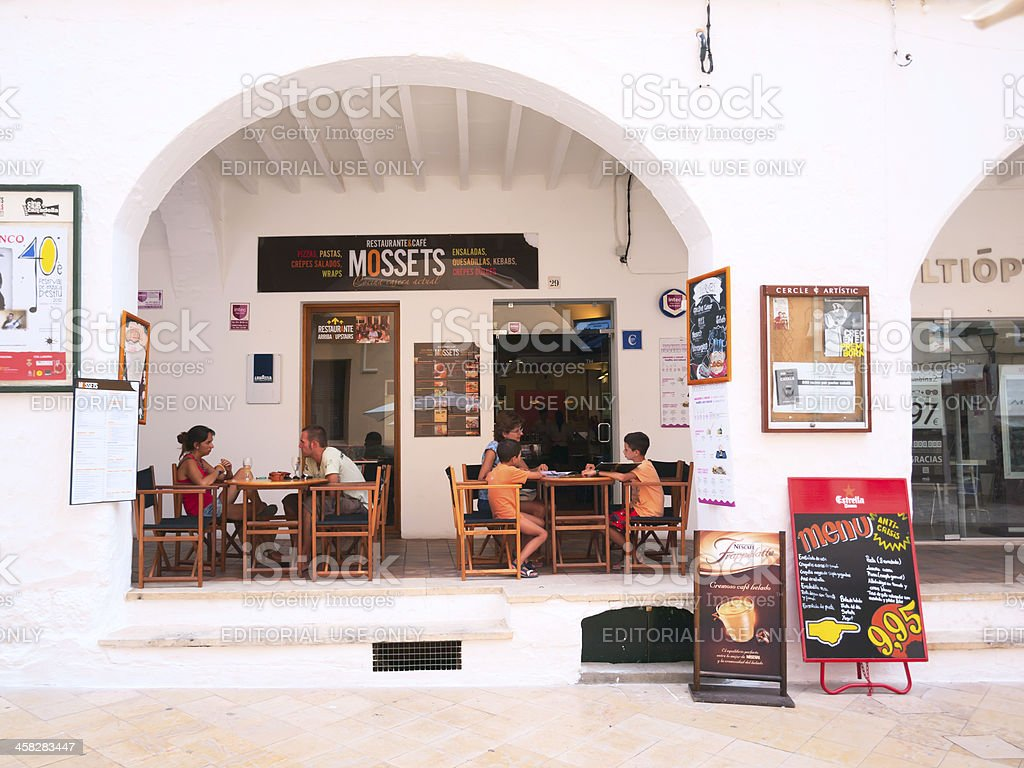 Street cafe in arch, Menorca, Spain stock photo