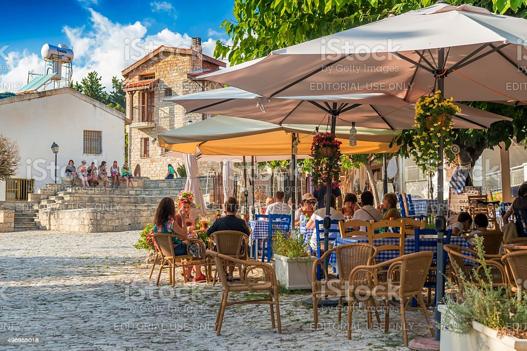 Street cafe's with tourists in Omodos village, Limassol District. stock photo