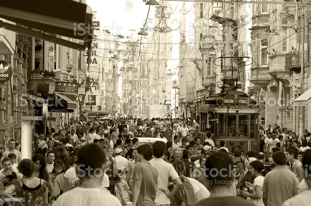 Tram and thick crowd on istiklal Avenue in Istanbul royalty-free stock photo