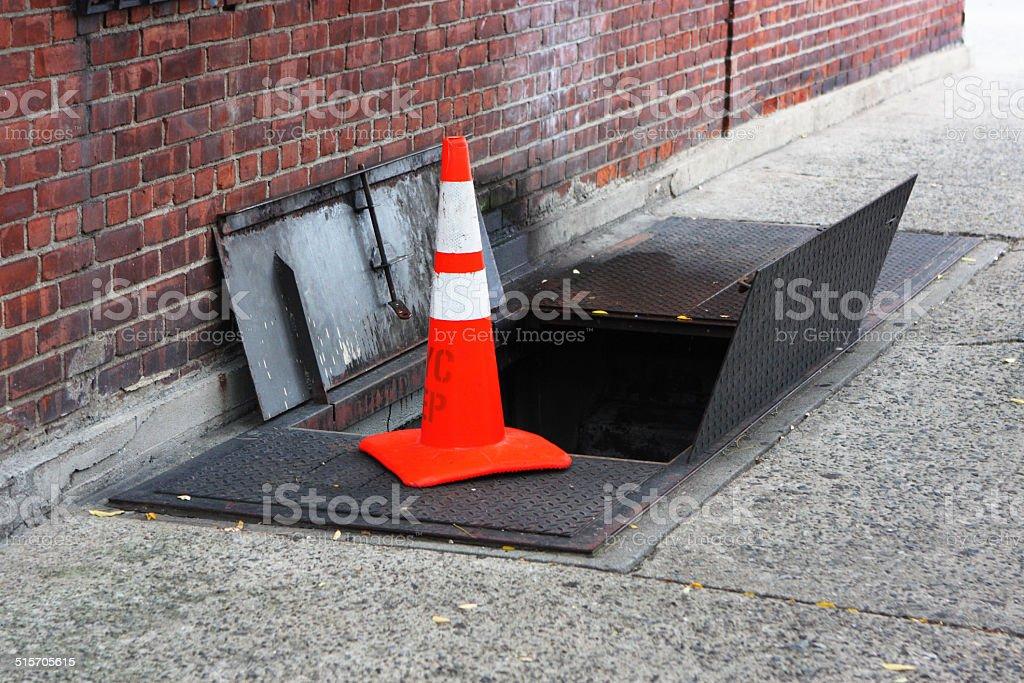 Street Cellar Safety Cone stock photo