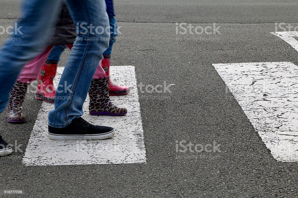 Street - children crossing a crosswalk stock photo