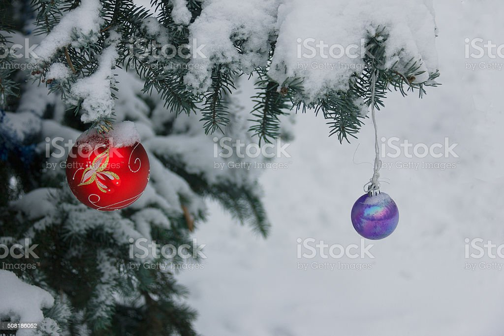 Street Christmas tree decorated with the multicolored balls stock photo