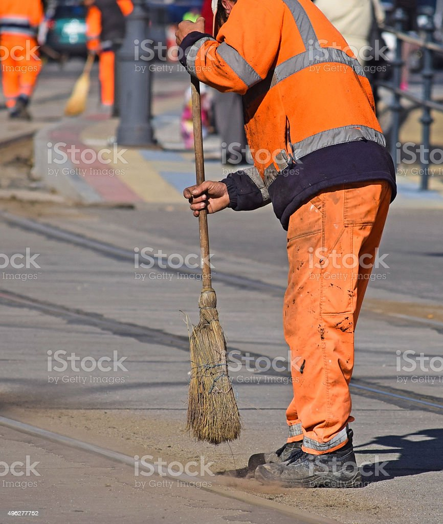 Street cleaner at work stock photo