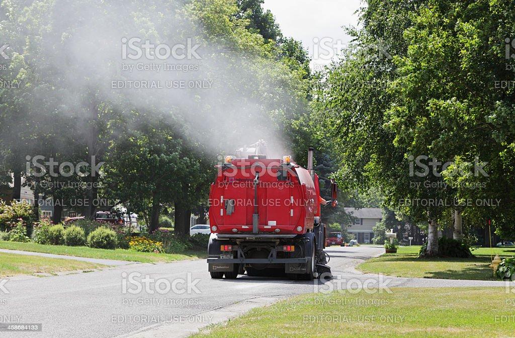 Street Cleaner Vacuum Truck in Suburban Neighborhood stock photo
