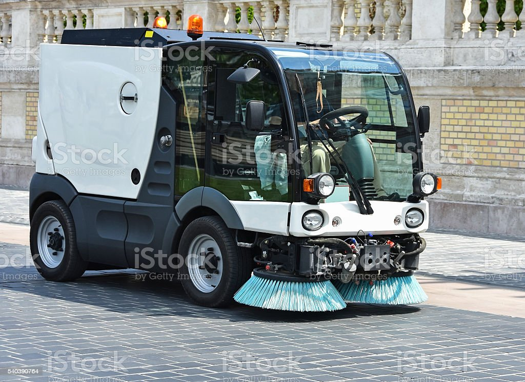 Street cleaner vehicle at work stock photo
