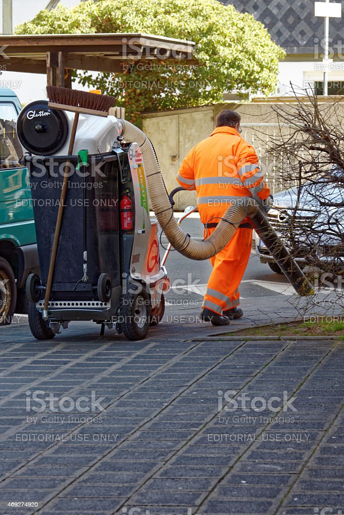 street cleaner with vaccum cleaner stock photo