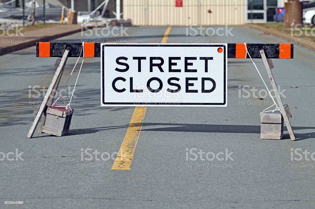 Street Closed Sign Attached To A Road Barricade stock photo