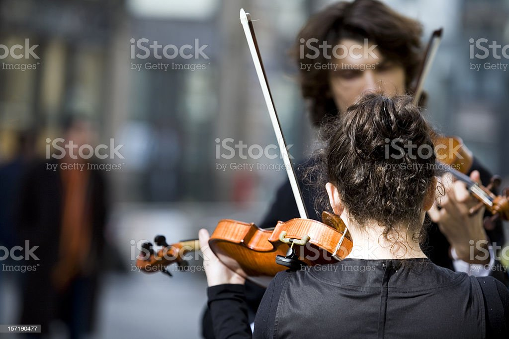 A street concerto with violins stock photo