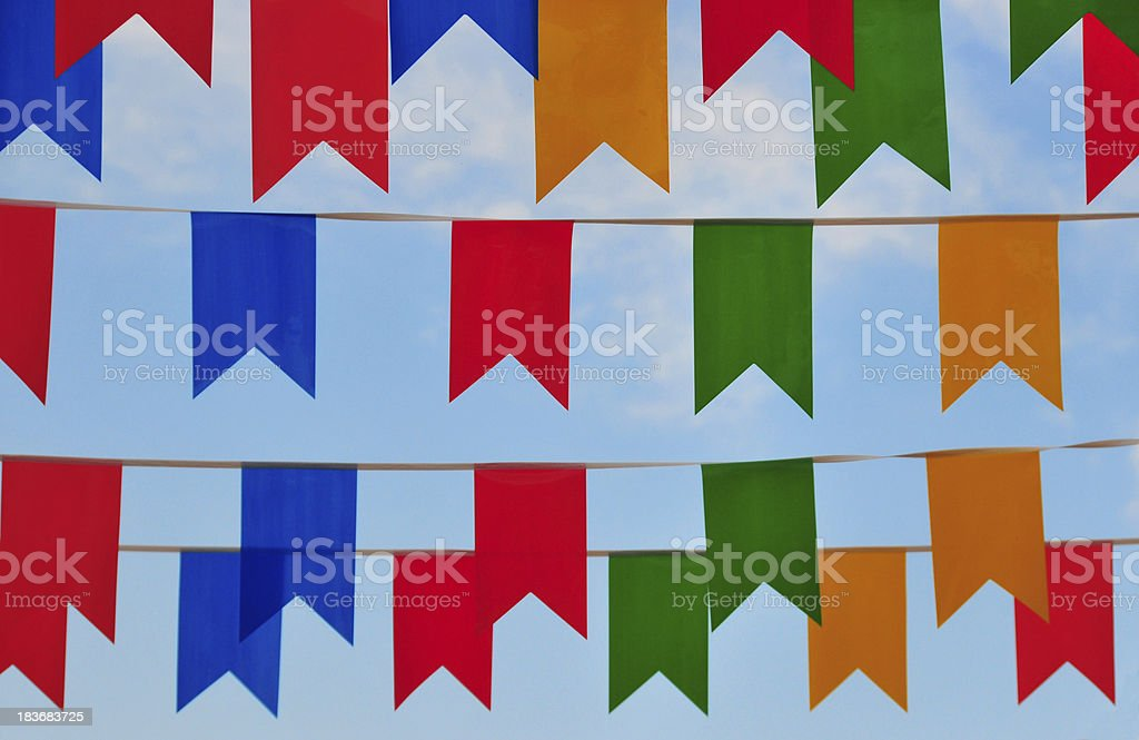 street covered in colorful banners stock photo