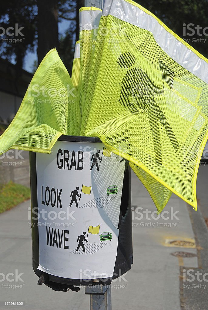 Street crossing flags for pedestrians stock photo