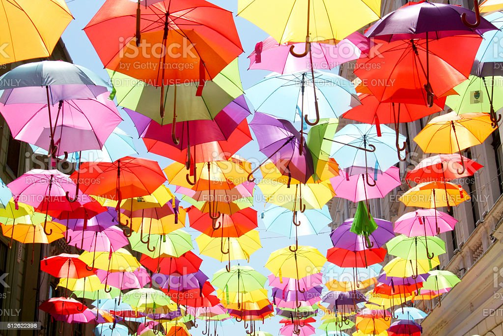 Street decorated with colored and open umbrellas stock photo