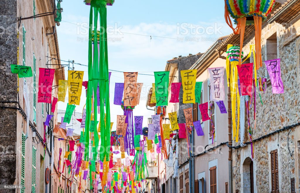 Street decorated with colorful signs. stock photo