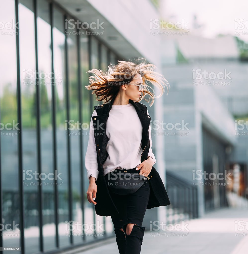 Street fashion concept. Young beautiful model in the city. stock photo