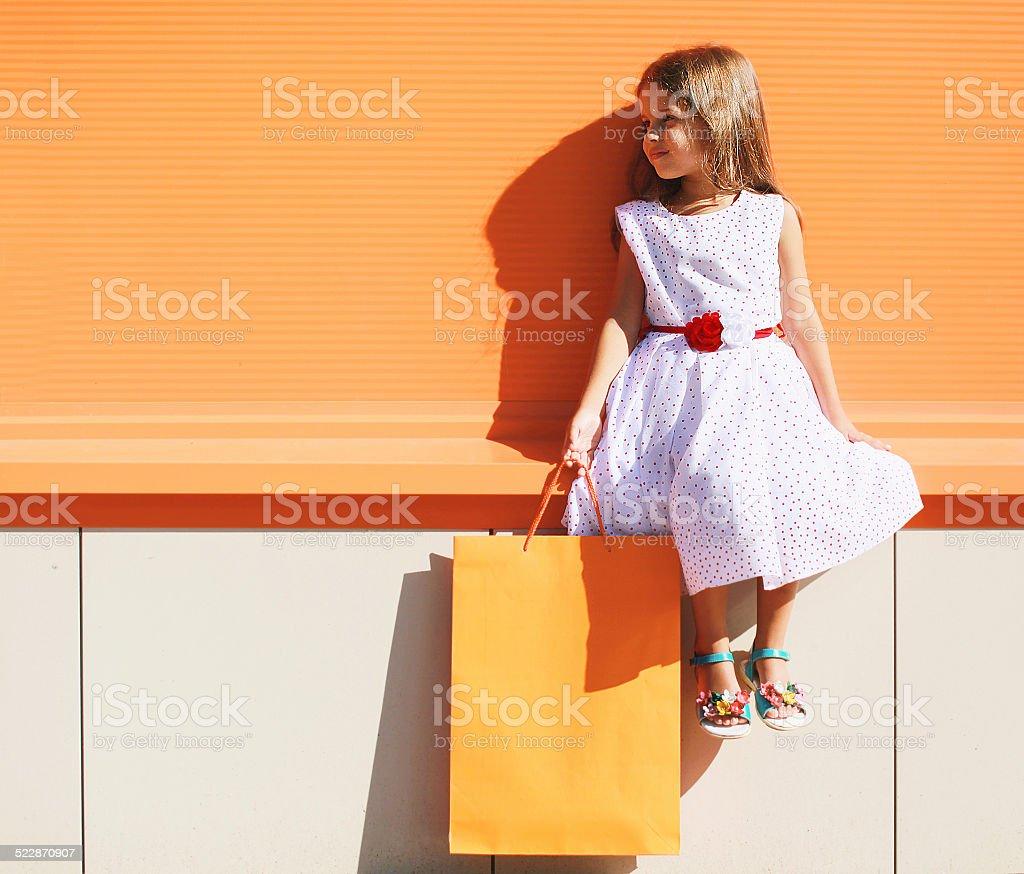 Street fashion kid, pretty little girl in dress stock photo