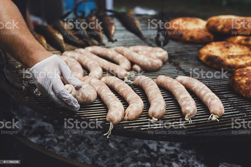 Street fast food, grilled sausages at bbq stock photo