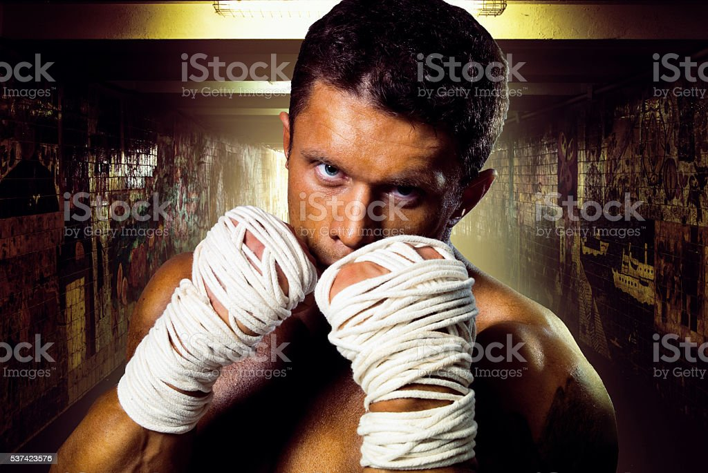 Street fighter muscular rack attack wrapped stock photo