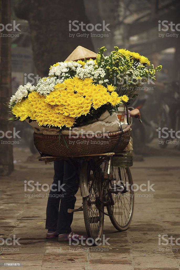 Street flower vendor with bicycle, Hanoi, Vietnam stock photo