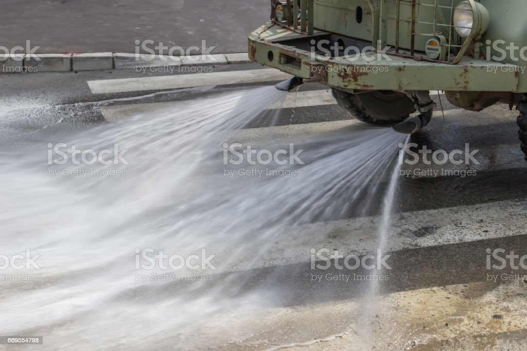 Street flusher in action 2 stock photo