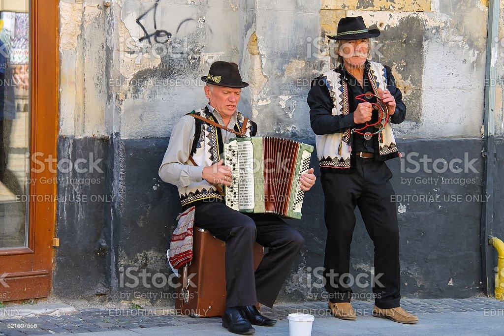 Street folk musicians on performing in historic center of Lviv, stock photo