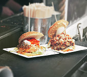 Street food burgers with meat, vegetables and mayonnaise