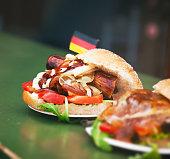 Street food german burger with sausage, vegetables, ketchup
