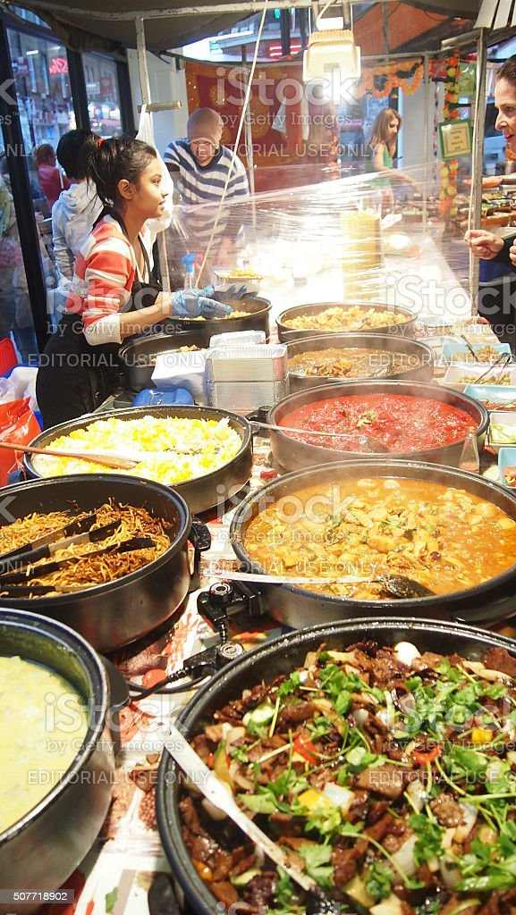Street food market selling Malaysian curry stock photo