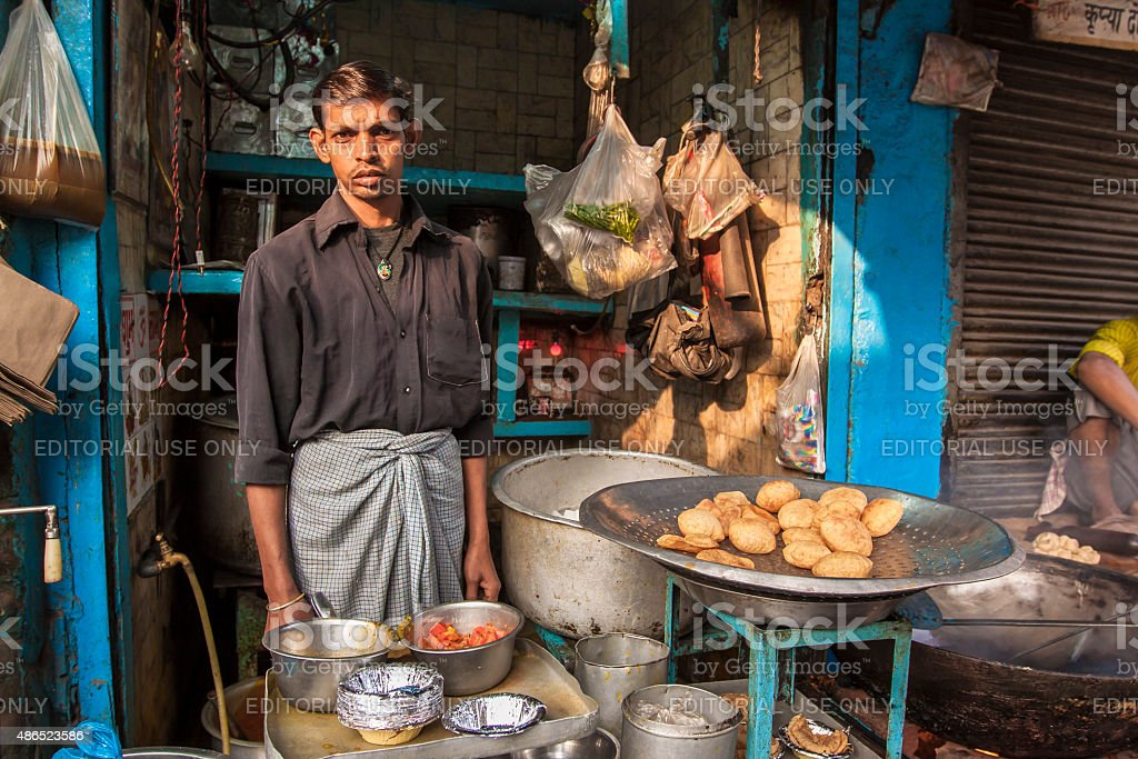 Street Food Vendor cooking and selling food stuff stock photo