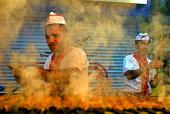 Street food vendor cooks kebab in the street of Adana.