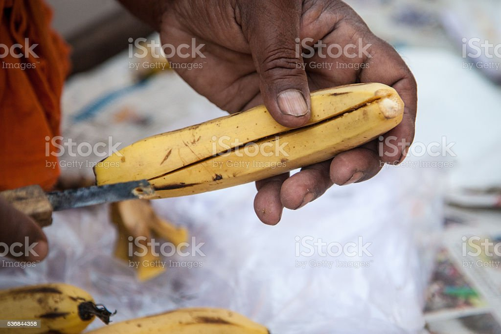 Street food vendor preparing bananas stock photo