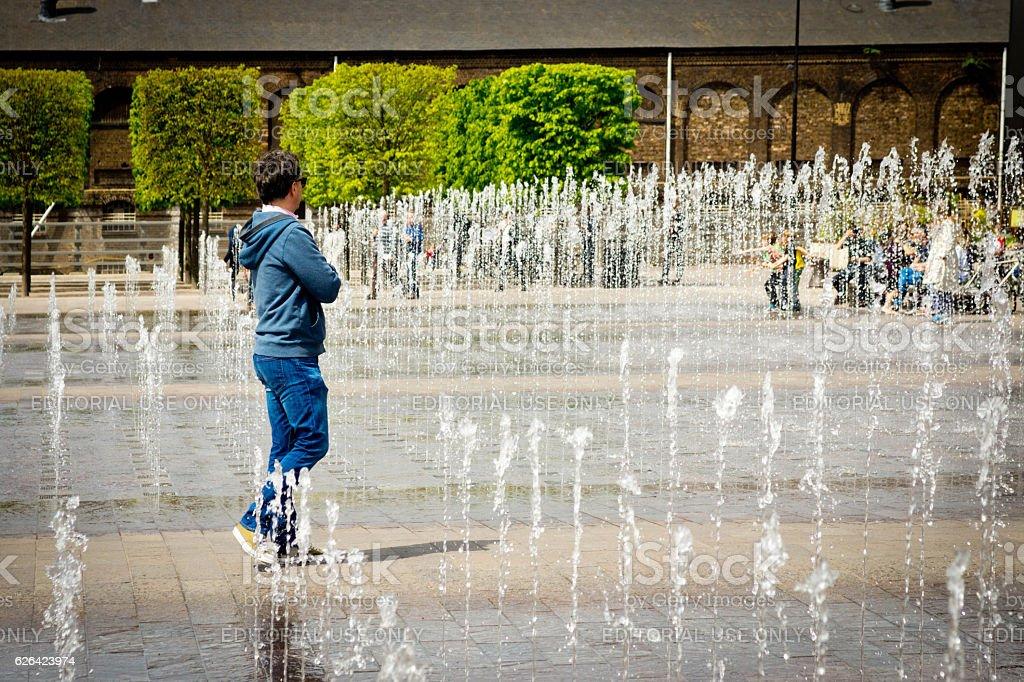 Street fountain Kings Cross stock photo