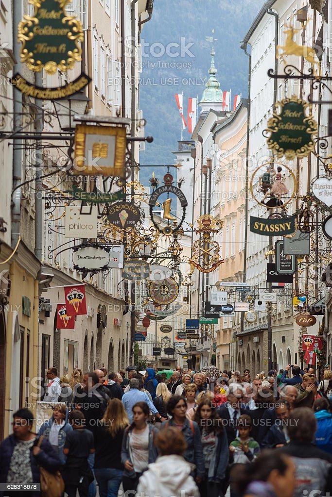 Street Getreidegasse with multiple advertising signs, Salzburg stock photo