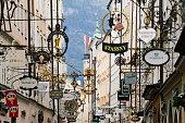 Street Getreidegasse with multiple advertising signs, Salzburg