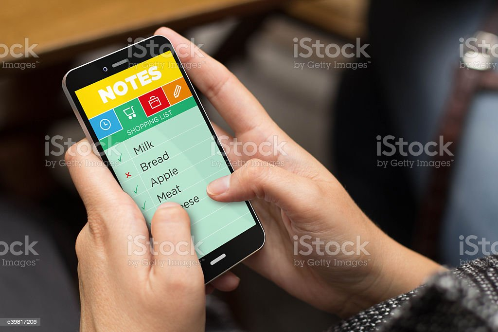 street girl cheking note app with a smartphone stock photo