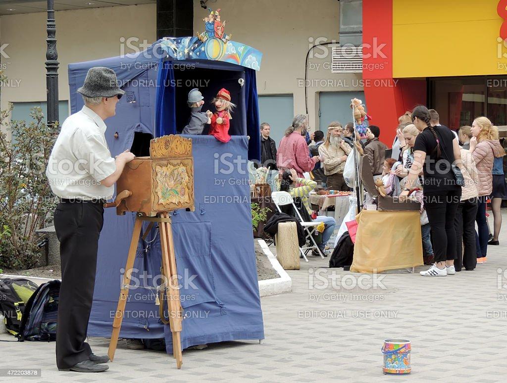 Street hand-organ puppet show stock photo