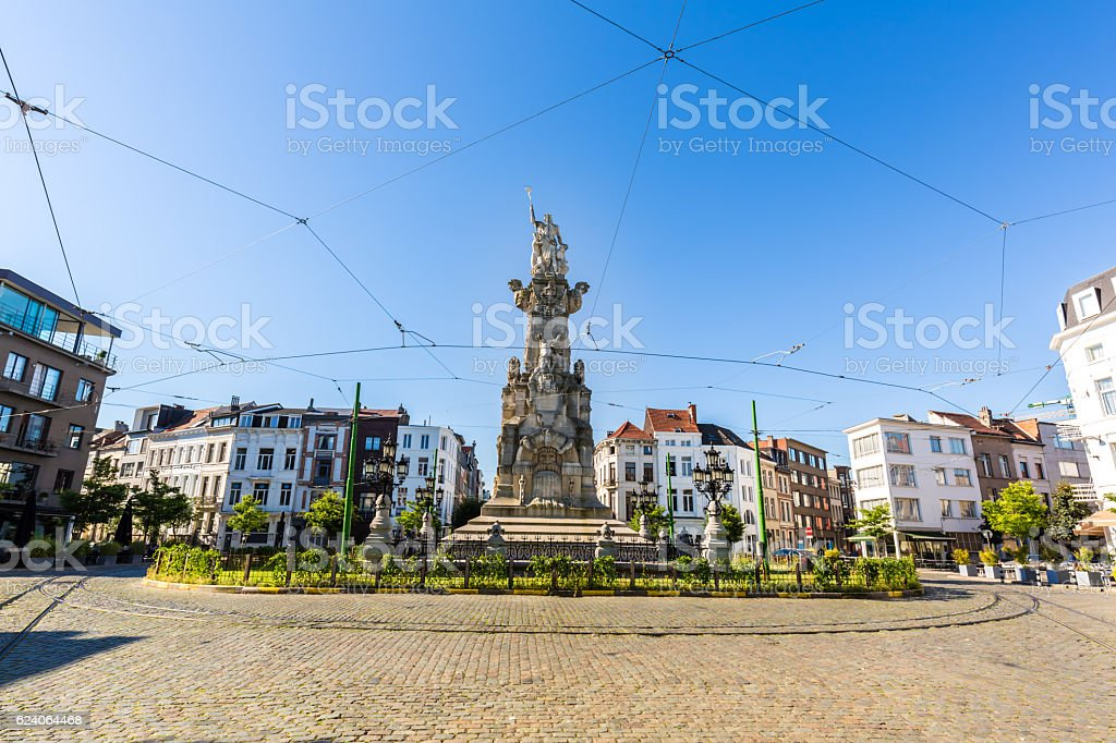 Street in Antwerp with old Statue stock photo