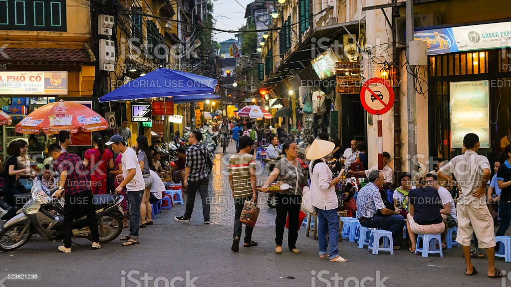 Street in Hanoi, Vietnam during twilight stock photo