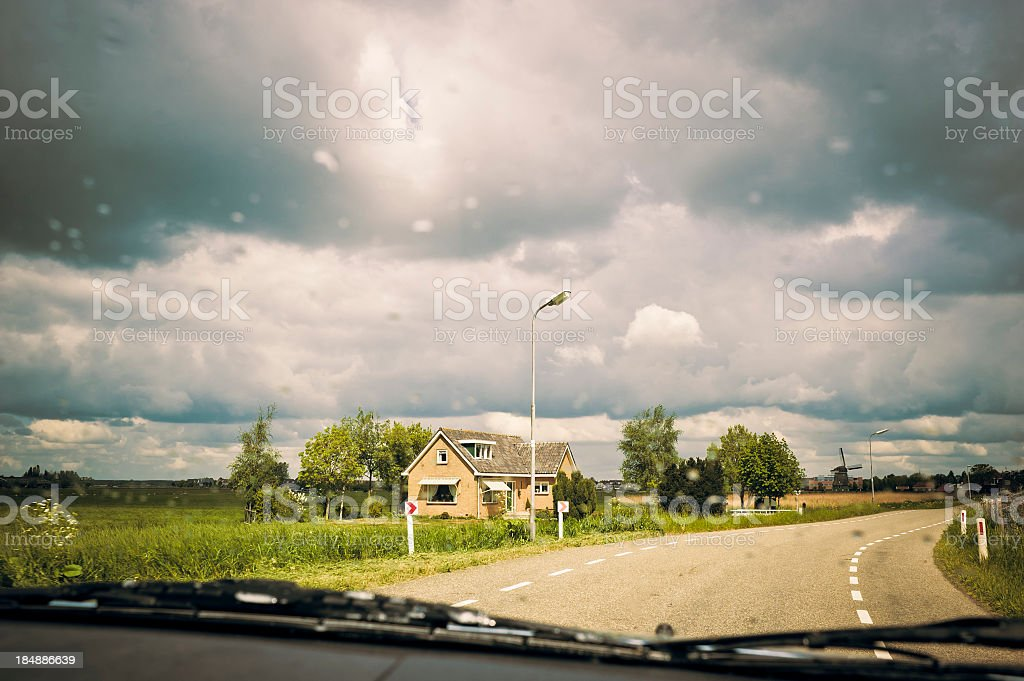 Street In Holland With Rain View Behind A Car Windscreen royalty-free stock photo
