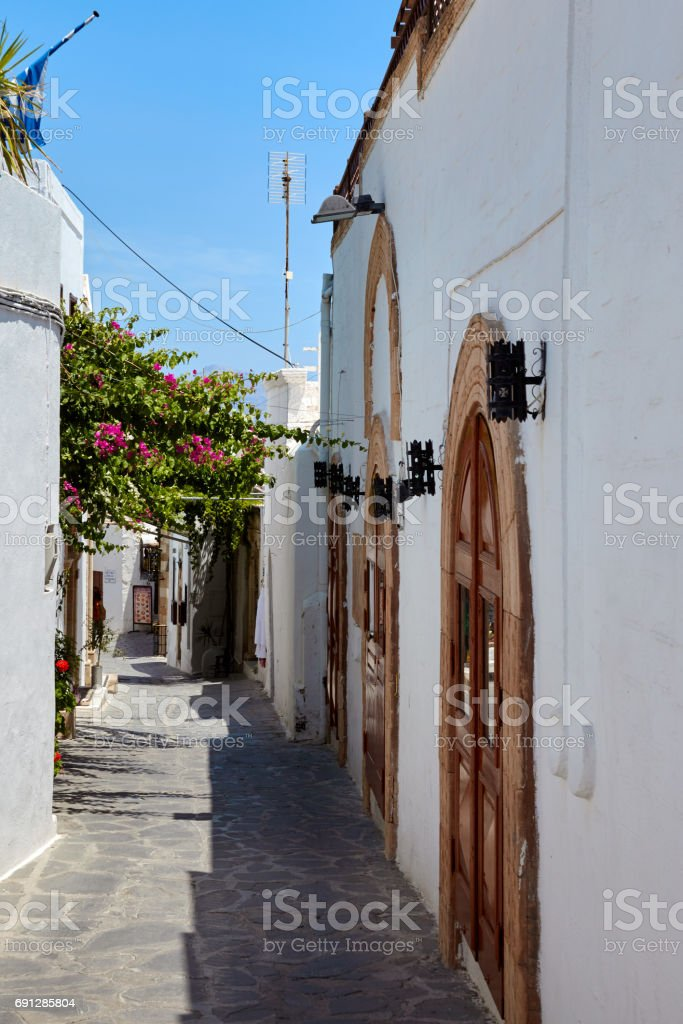 Street in Lindos city, Rhodes island, Greece stock photo