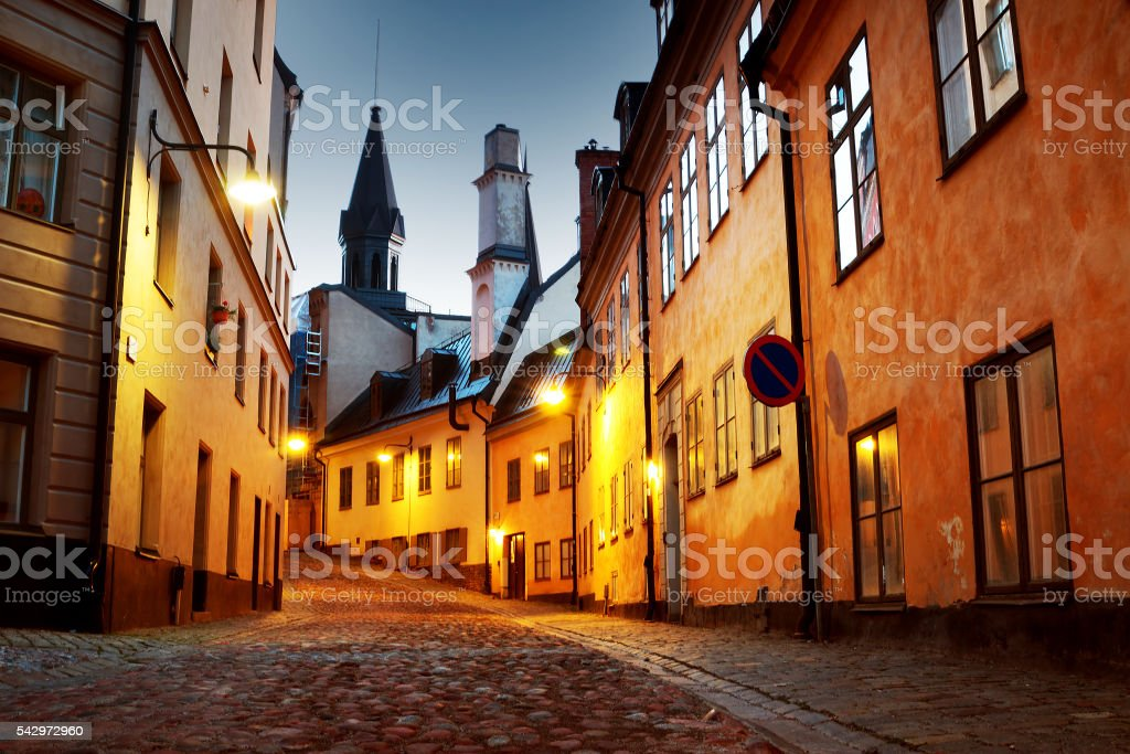 Street in old town Stockholm at night stock photo
