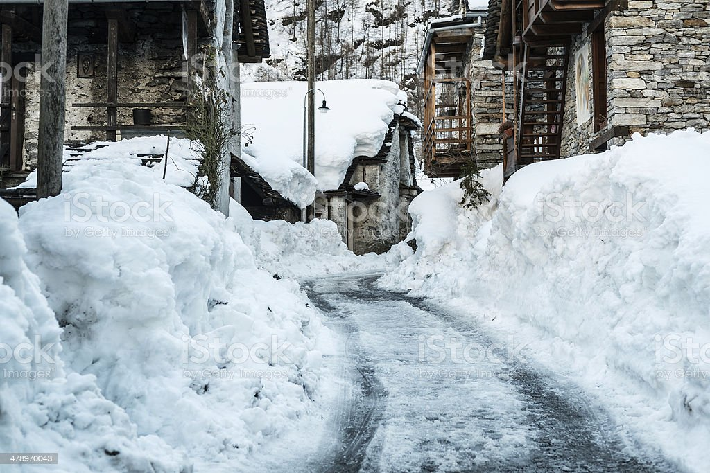 Street in old village, winter season - Sonogno stock photo