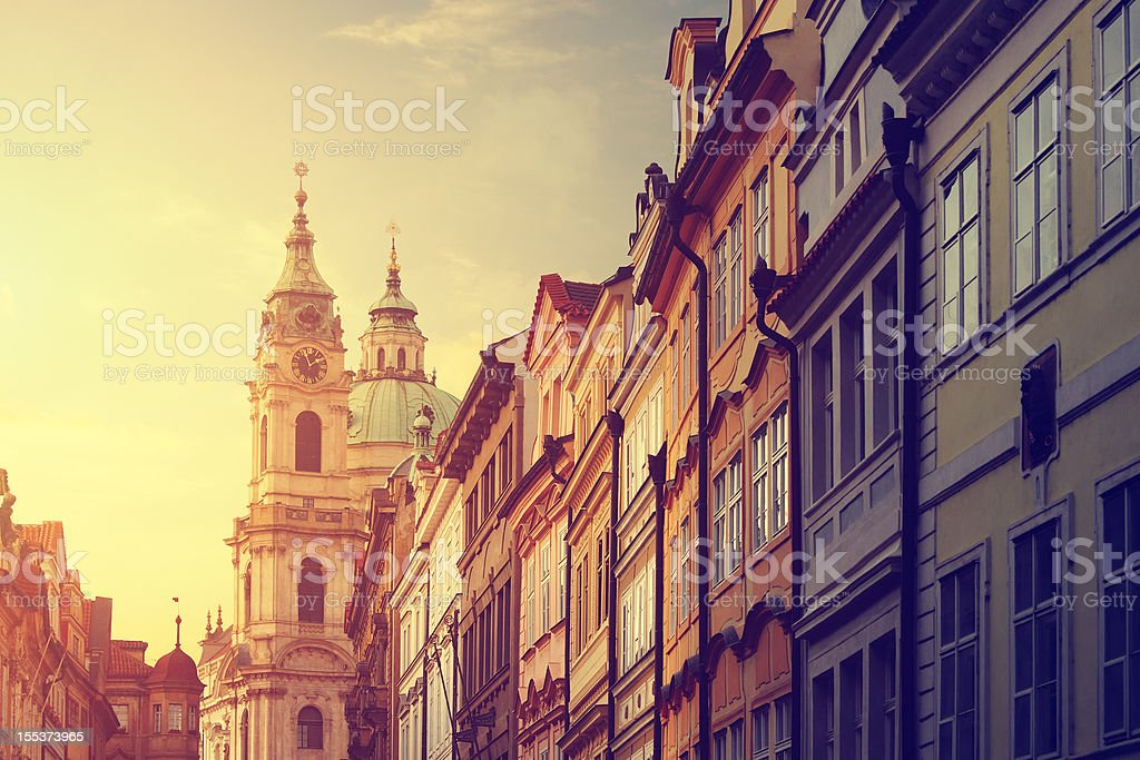 Street in Prague with the St. Nicholas Church stock photo