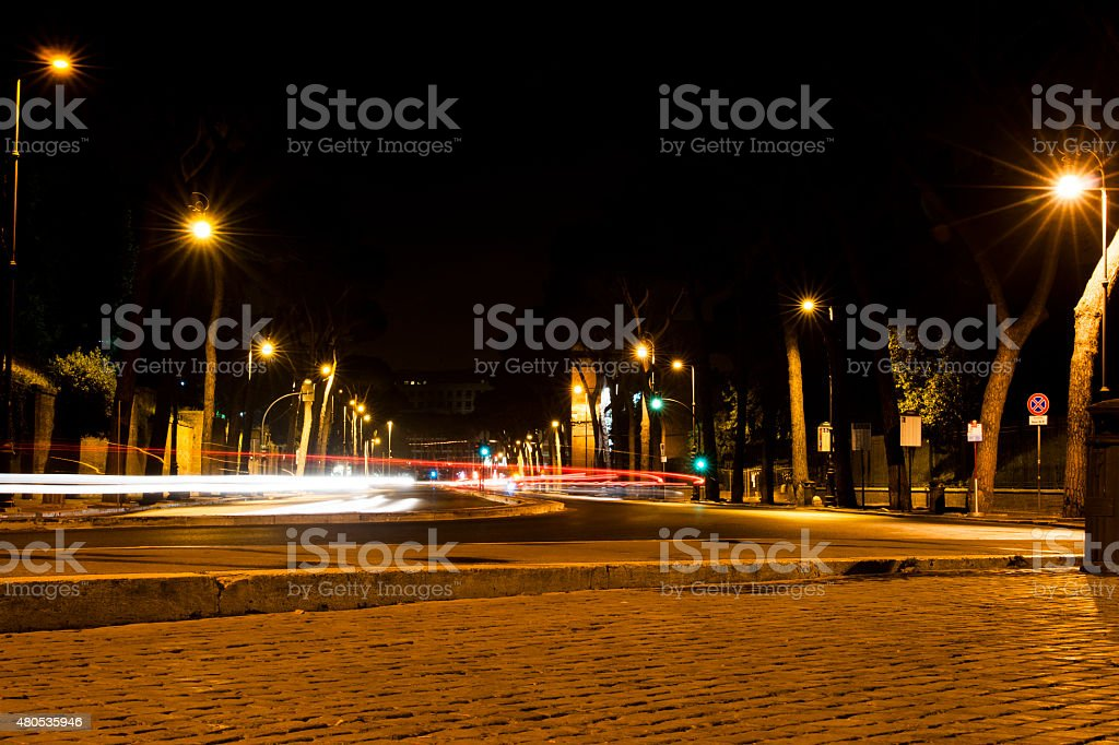 street in Rome at night with light trails stock photo