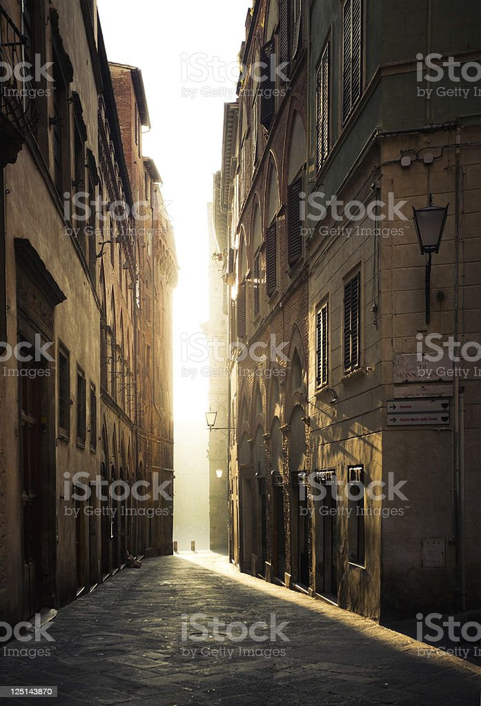 Street in Siena, Italy - empty in a morning stock photo